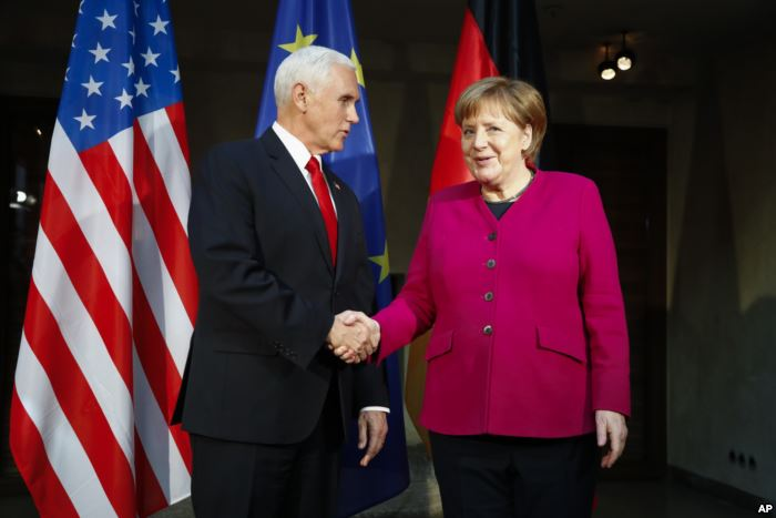 German Chancellor Angela Merkel, right, welcomes United States Vice President