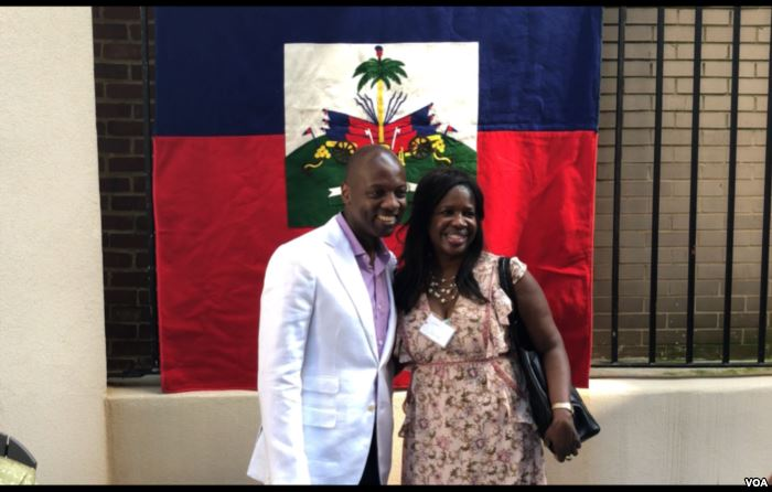 Haiti's Ambassador to the US, Paul Altidor poses for a selfie with one of