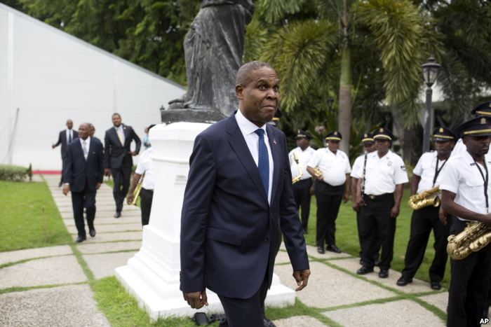 Haiti's prime minister Jean-Henry Ceant walks after his ratification cere
