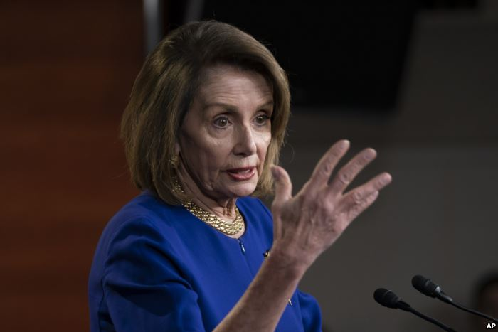 Speaker of the House Nancy Pelosi, D-Calif., talks with reporters during her