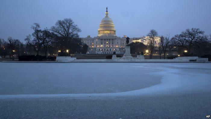 The Capitol is seen with the Reflecting Pool covered in ice and snow, in Wash