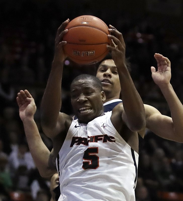 Pacific's Anthony Townes (5) pulls in a rebound in front of Gonzaga's Brandon Clarke during the first half of an NCAA college basketball game Thursday, Feb. (AP Photo/Ben Margot)