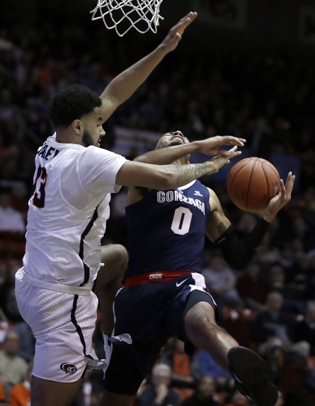 Pacific's Jeremiah Bailey, left, defends against Gonzaga's Geno Crandall (0) in the first half of an NCAA college basketball game Thursday, Feb. (AP Photo/Ben Margot)