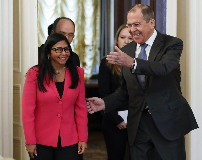 Russian Foreign Minister Sergey Lavrov, right, welcomes Venezuela's Vice President Delcy Rodriguez for talks in Moscow, Russia, Friday, March 1, 2019. (AP Photo/Pavel Golovkin)