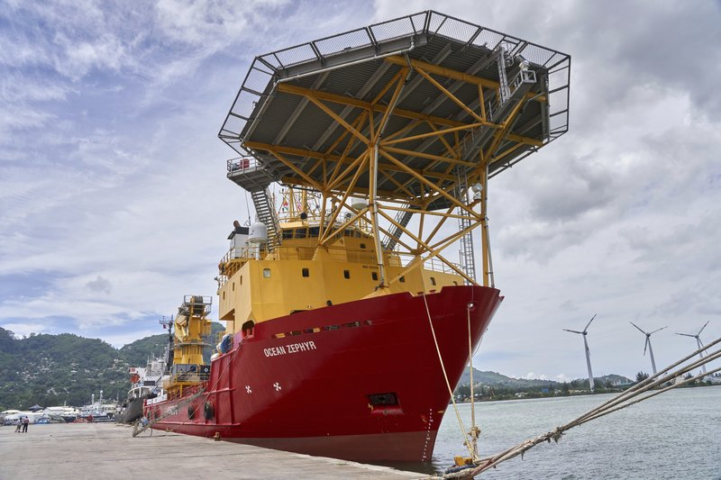 The research vessel Ocean Zephyr docked in Victoria, the Seychelles, on Friday March 1, 2019, where it will spend several days loading and testing equipment ahead of a weeks-long expedition to explore the depths of the Indian Ocean. (AP Photo/Steve Barker)