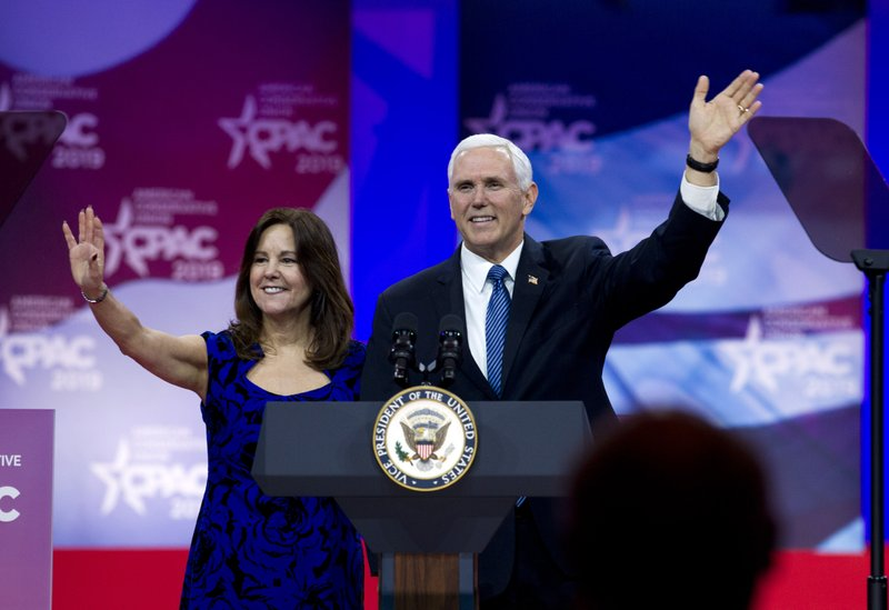 Vice President Mike Pence accompanied by his wife Karen Pence waves to the audience before speaking at Conservative Political Action Conference, CPAC 2019, in Oxon Hill, Md. (AP Photo/Jose Luis Magana)