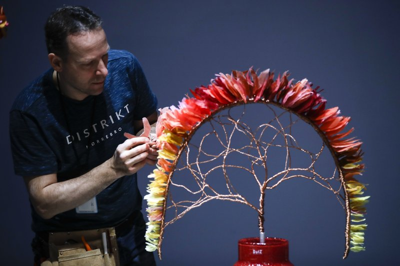 Florist Hans Zijlstra of the Netherlands competes in the FTD World Cup floral design competition during a preview of the