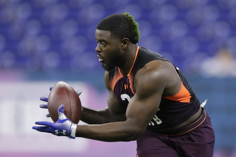 Notre Dame running back Dexter Williams runs a drill during the NFL football scouting combine, Friday, March 1, 2019, in Indianapolis. (AP Photo/Darron Cummings)
