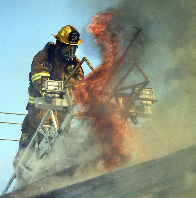 Dover firefighter battles a four-alarm fire at a three-story apartment building, Friday, March 1, 2019, in Berwick, Maine. (Deb Cram/Foster's Daily Democrat via AP)