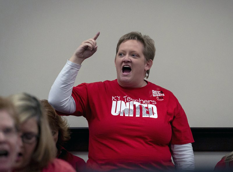Kristin Walker, a Jefferson County teacher shouts in a hearing room to protest a bill that would change how individuals are nominated to the Kentucky teachers retirement systems board of trustees, in Frankfort,, Ky, Thursday, Feb 28, 2019. (AP Photo/Bryan Woolston)