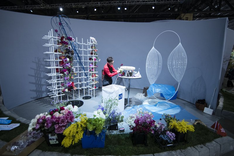 Florist Solomon Leong of Hong Kong competes in the FTD World Cup floral design competition during a preview of the