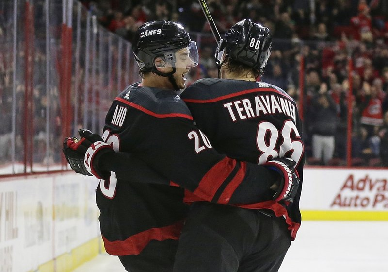 Carolina Hurricanes' Sebastian Aho (20), of Finland, celebrates his goal against the St. Louis Blues with Hurricanes' Teuvo Teravainen (86), of Finland, during the second period of an NHL hockey game in Raleigh, N. (AP Photo/Gerry Broome)
