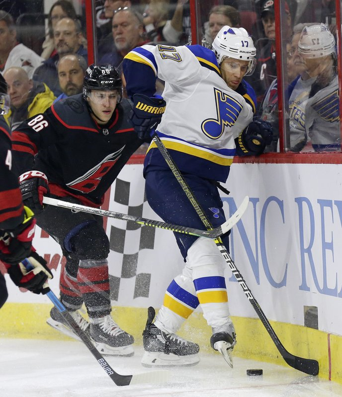 Carolina Hurricanes' Teuvo Teravainen (86), of Finland, chases the puck with St. Louis Blues' Jaden Schwartz (17) during the first period of an NHL hockey game in Raleigh, N. (AP Photo/Gerry Broome)