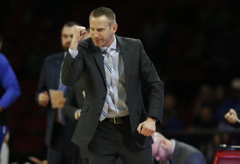Miami (Ohio) head coach Jack Owens cheers his team against Buffalo during the first half of an NCAA college basketball game, Friday, March 1, 2019, in Oxford, Ohio. (AP Photo/Gary Landers)