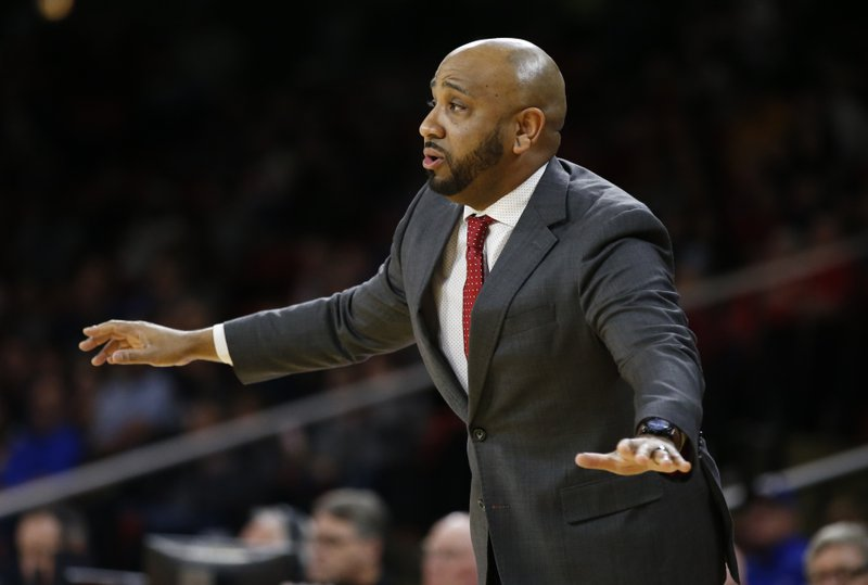Miami (Ohio) head coach Jack Owens watches his team play against Buffalo during the first half of an NCAA college basketball game, Friday, March 1, 2019, in Oxford, Ohio. (AP Photo/Gary Landers)