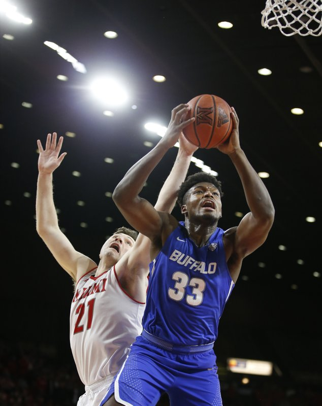 Buffalo forward Nick Perkins (33) shoots infant of Miami (Ohio) forward Aleks Abrams (21) during the first half of an NCAA college basketball game, Friday, March 1, 2019, in Oxford, Ohio. (AP Photo/Gary Landers)