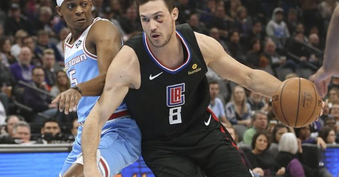e9bd4ecb13a Los Angeles Clippers forward Danilo Gallinari, right, drives against  Sacramento Kings guard De'Aaron Fox during the first quarter of an NBA  basketball game ...
