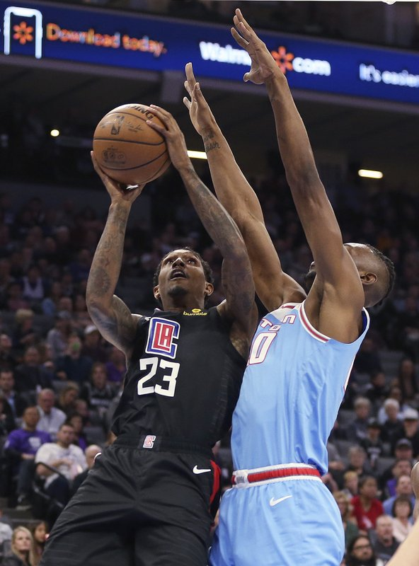 b1ad68ca160 Los Angeles Clippers guard Lou Williams, left, goes to the basket against  Sacramento Kings