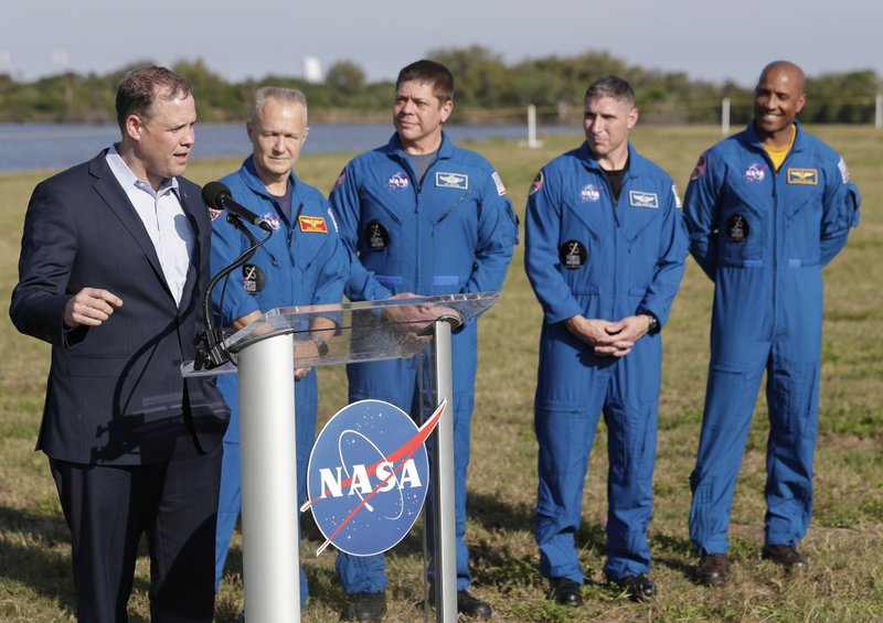 NASA Administrator Jim Bridenstine, left, speaks at a news conference with astronauts, from second left, Doug Hurley, Bob Behnken, Mike Hopkins and Victor Glover before Saturday's Falcon 9 SpaceX Crew Demo-1 rocket launch at the Kennedy Space Center in Cape Canaveral, Fla. (AP Photo/John Raoux)