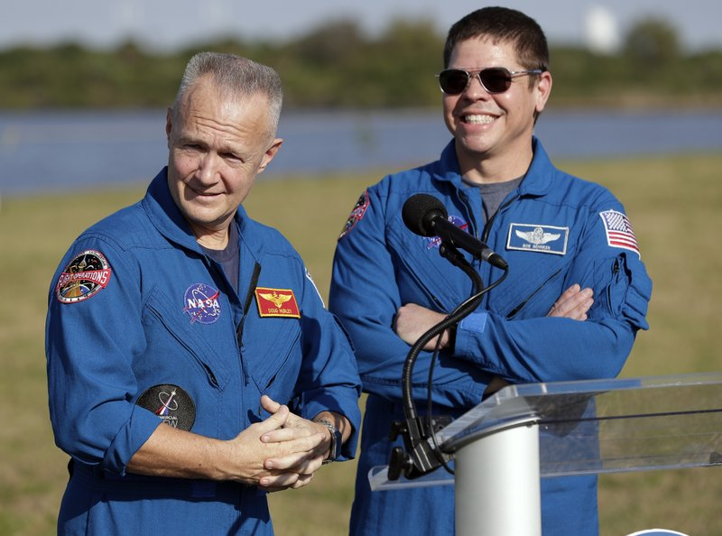 NASA astronauts Doug Hurley, left, and Bob Behnken answer questions during a news conference before the Falcon 9 SpaceX Crew Demo-1 rocket launch at the Kennedy Space Center in Cape Canaveral, Fla. (AP Photo/John Raoux)