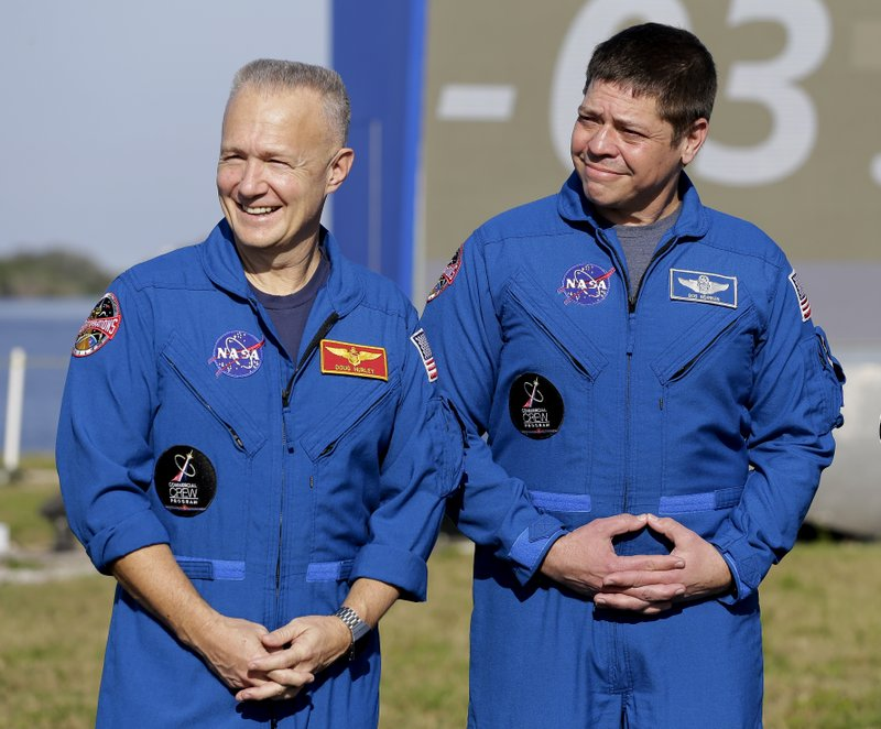 NASA astronauts Doug Hurley, left, and Bob Behnken attend a news conference before the Falcon 9 SpaceX Crew Demo-1 rocket launch at the Kennedy Space Center in Cape Canaveral, Fla. (AP Photo/Terry Renna)