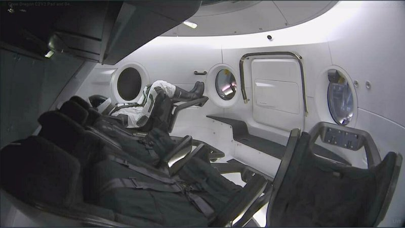 This photo provided by SpaceX shows a test dummy in the new Dragon capsule designed for astronauts.  A six-day test flight will be real in every regard, beginning with a Florida liftoff Saturday, March 2, 2019 and a docking the next day with the International Space Station. (SpaceX via AP)