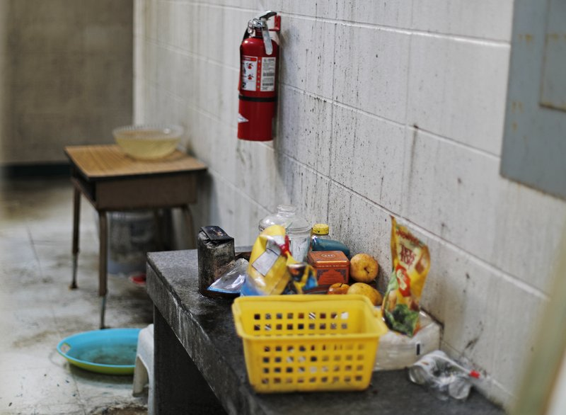Mold grows on the wall and food left behind in a classroom since Hurricane Michael damaged Springfield Elementary School in Panama City, Fla, Thursday, Jan. (AP Photo/David Goldman)