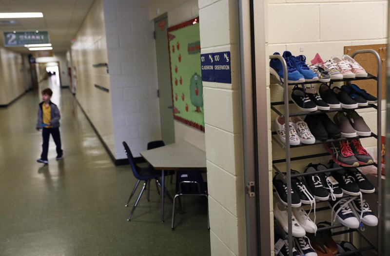 A broom closet in Northside Elementary School is filled with donated shoes for students whose homes were destroyed by Hurricane Michael in Panama City, Fla, Thursday, Jan. (AP Photo/David Goldman)
