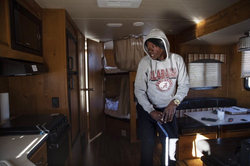 Rickie Keith stands in the FEMA trailer he just moved into after his home was damaged by Hurricane Michael in Panama City, Fla, Thursday, Jan. (AP Photo/David Goldman)