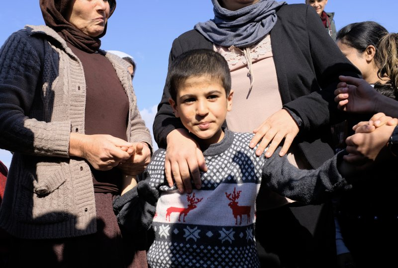 Dilbar Ali Ravu, 10, is reunited with his family in Iraq after five years of captivity with the Islamic State group, Saturday, March 2, 2019. (AP Photo/Philip Issa)