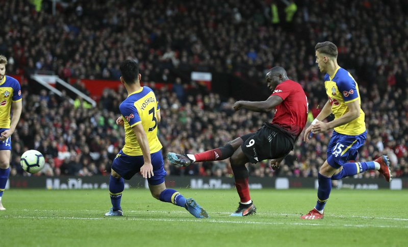 Manchester United's Romelu Lukaku scores his side's third goal of the game,  during the English Premier League soccer match between Manchester United and Southampton at Old Trafford, in Manchester, England, Saturday, March 2, 2019. (Martin Rickett/PA via AP)