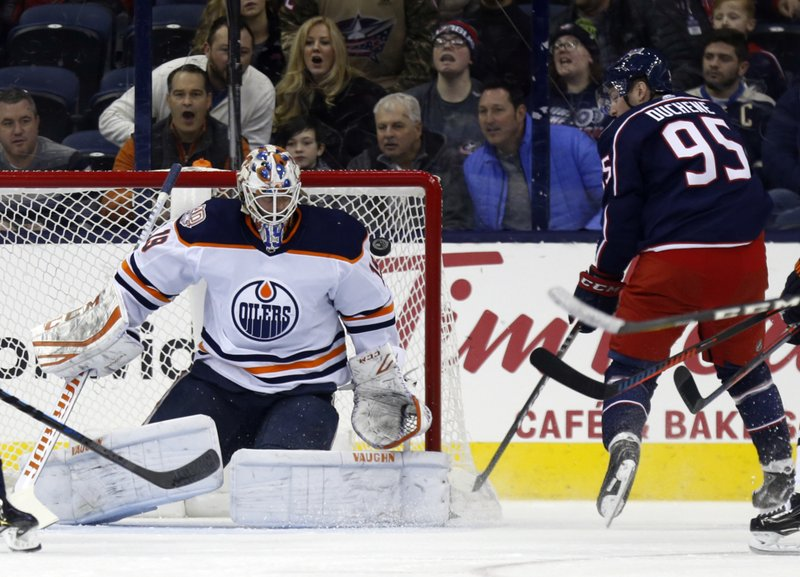 Edmonton Oilers goalie Mikko Koskinen, left, of finland, makes a stop against Columbus Blue Jackets forward Matt Duchene during the first period of an NHL hockey game in Columbus, Ohio, Saturday, March 2, 2019. (AP Photo/Paul Vernon)