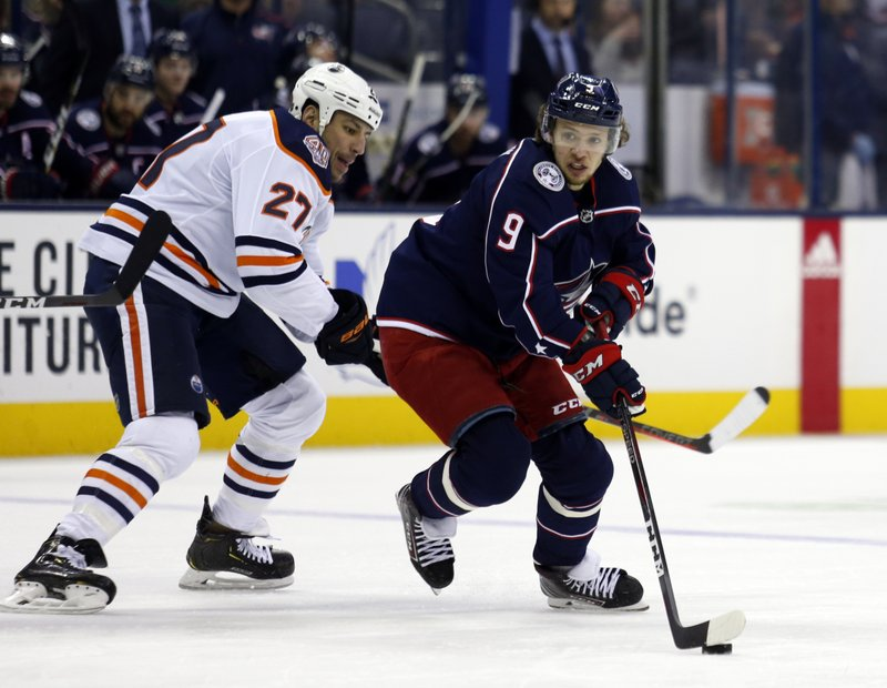 Columbus Blue Jackets forward Artemi Panarin, left, of Russia, skates past Edmonton Oilers forward Milan Lucic during the first period of an NHL hockey game in Columbus, Ohio, Saturday, March 2, 2019. (AP Photo/Paul Vernon)