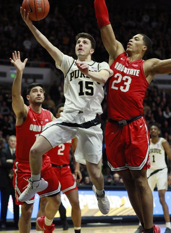 Purdue guard Tommy Luce (15) shoots the basketball defended by Ohio State forward Jaedon Ledee (23) and guard Joey Lane in the second half of an NCAA college basketball game, Saturday, March 2, 2019, in West Lafayette, Ind. (AP Photo/R Brent Smith)