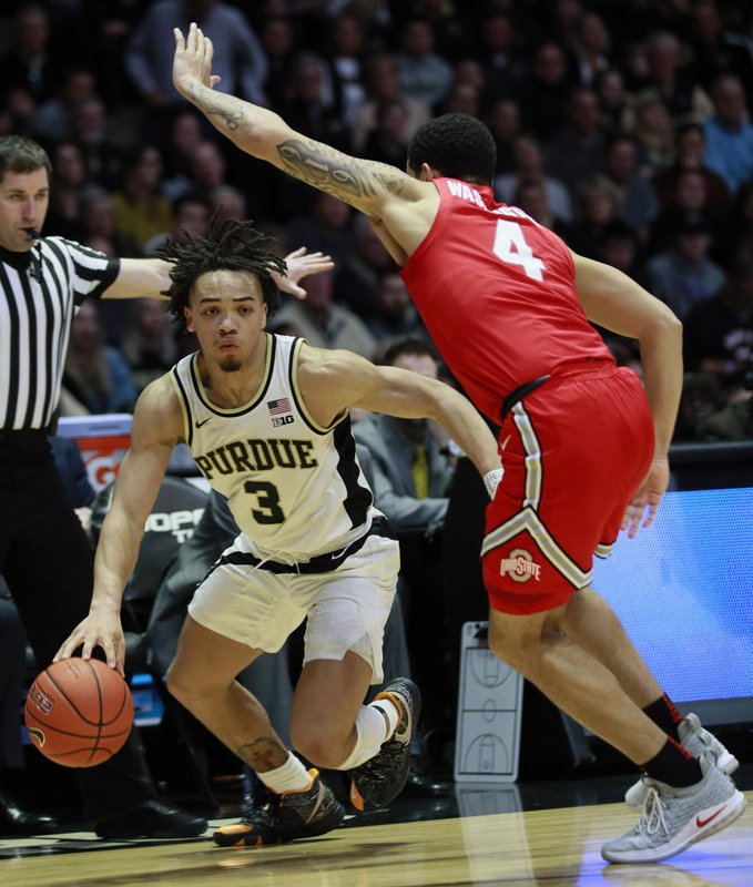 Purdue guard Carsen Edwards (3) controls the basketball guarded by Ohio State guard Duane Washington in the second half of an NCAA college basketball game, Saturday, March 2, 2019, in West Lafayette, Ind. (AP Photo/R Brent Smith)