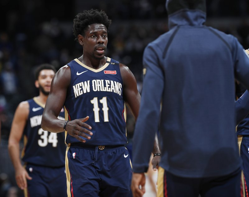 New Orleans Pelicans guard Jrue Holiday (11) is congratulated by teammates after hitting a basket late in the second half of an NBA basketball game against the Denver Nuggets, Saturday, March 2, 2019, in Denver. (AP Photo/David Zalubowski)