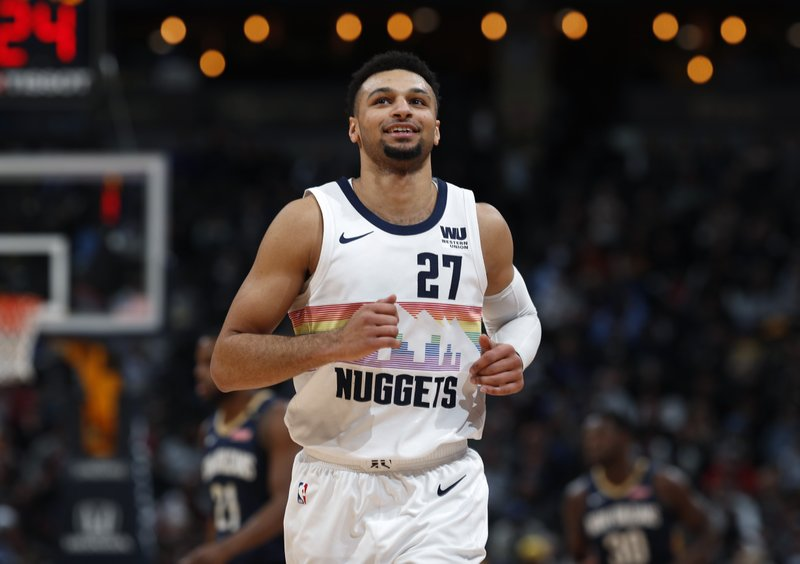 Denver Nuggets guard Jamal Murray reacts as he drops back on defense after hitting a three-point basket against the New Orleans Pelicans in the first half of an NBA basketball game Saturday, March 2, 2019, in Denver. (AP Photo/David Zalubowski)