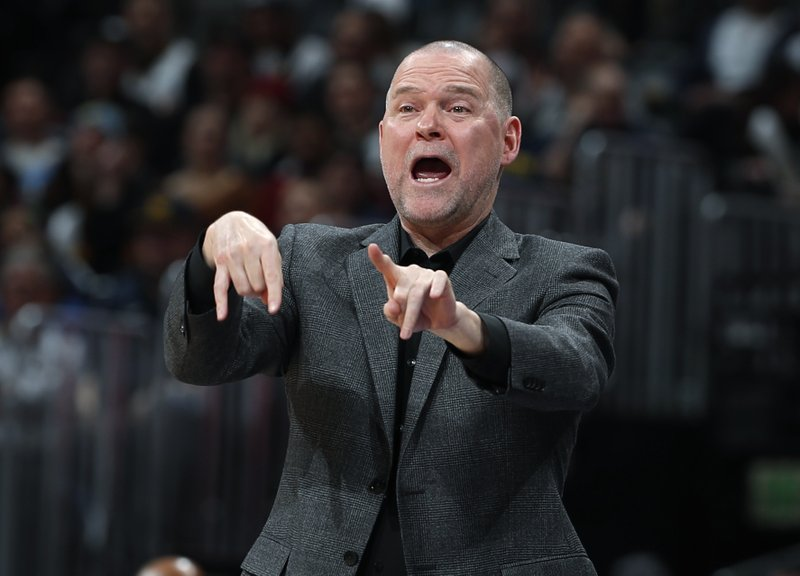 Denver Nuggets head coach Michael Malone directs his team against the New Orleans Pelicans in the first half of an NBA basketball game Saturday, March 2, 2019, in Denver. (AP Photo/David Zalubowski)