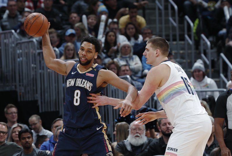 New Orleans Pelicans center Jahlil Okafor looks to pass the ball as Denver Nuggets center Nikola Jokic defends during the second half of an NBA basketball game Saturday, March 2, 2019, in Denver. (AP Photo/David Zalubowski)
