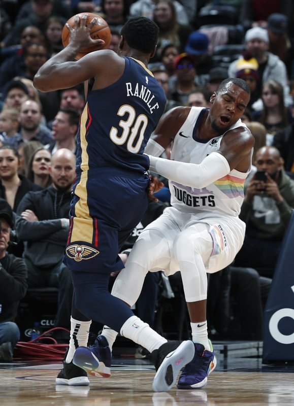 Denver Nuggets forward Paul Millsap, right, fouls New Orleans Pelicans center Julius Randle during the second half of an NBA basketball game Saturday, March 2, 2019, in Denver. (AP Photo/David Zalubowski)