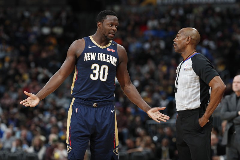 New Orleans Pelicans center Julius Randle argues with referee Tom Washington, who had called Randle for a foul on Denver Nuggets center Nikola Jokic during the second half of an NBA basketball game Saturday, March 2, 2019, in Denver. (AP Photo/David Zalubowski)