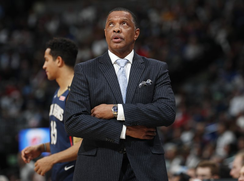 New Orleans Pelicans head coach Alvin Gentry checks the overhead scoreboard during a timeout against the Denver Nuggets in the first half of an NBA basketball game Saturday, March 2, 2019, in Denver. (AP Photo/David Zalubowski)