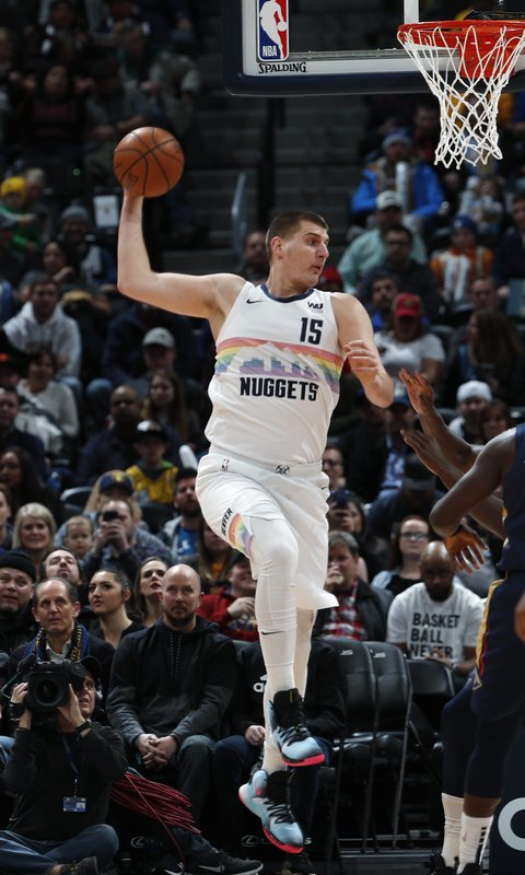 Denver Nuggets center Nikola Jokic pulls in a rebound against the New Orleans Pelicans in the first half of an NBA basketball game Saturday, March 2, 2019, in Denver. (AP Photo/David Zalubowski)