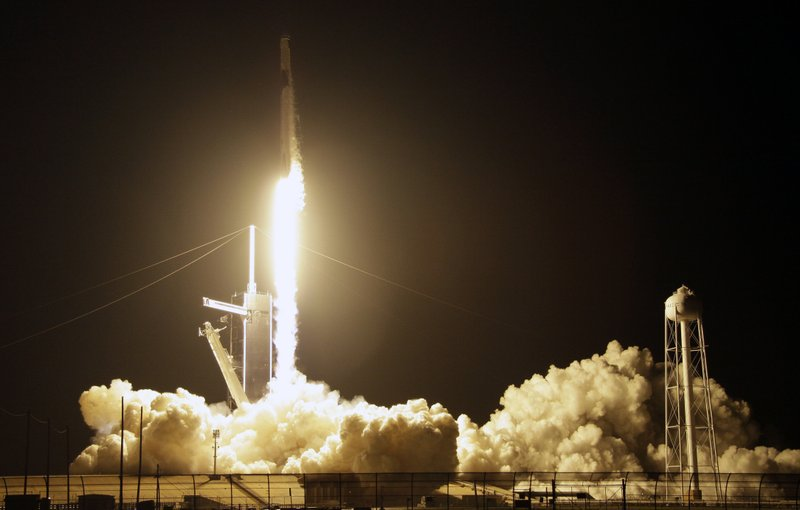 A SpaceX Falcon 9 rocket with a demo Crew Dragon spacecraft lifts off from pad 39A on an uncrewed test flight to the International Space Station at the Kennedy Space Center in Cape Canaveral, Fla. (AP Photo/Terry Renna)