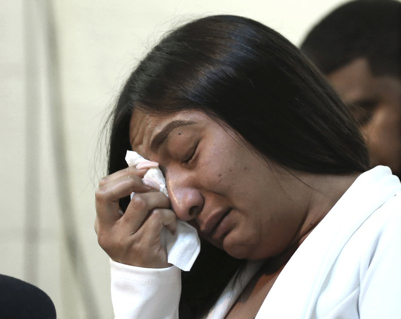 Salena Manni, the fiancee of Stephon Clark, who was shot and killed by Sacramento police in 2018, wipes tears from her eyes as she discusses the decision to not file charges against the two officers involved, during a news conference in Sacramento, Calif. (AP Photo/Rich Pedroncelli)