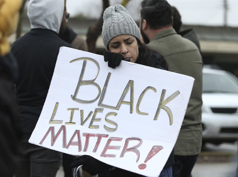 Brit Irby joins dozens of others in a demonstration outside the Sacramento Police Department to protest the decision to not prosecute the two officers involved in the 2018 fatal shooting of Stephon Clark, in Sacramento, Calif. (AP Photo/Rich Pedroncelli)