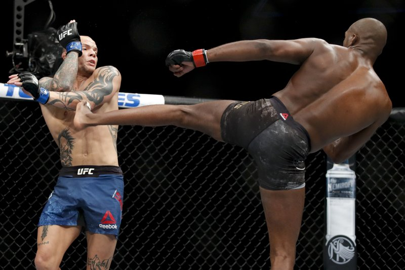 Jon Jones, right, kicks Anthony Smith during a light heavyweight mixed martial arts title bout at UFC 235, Saturday, March 2, 2019, in Las Vegas. (AP Photo/John Locher)