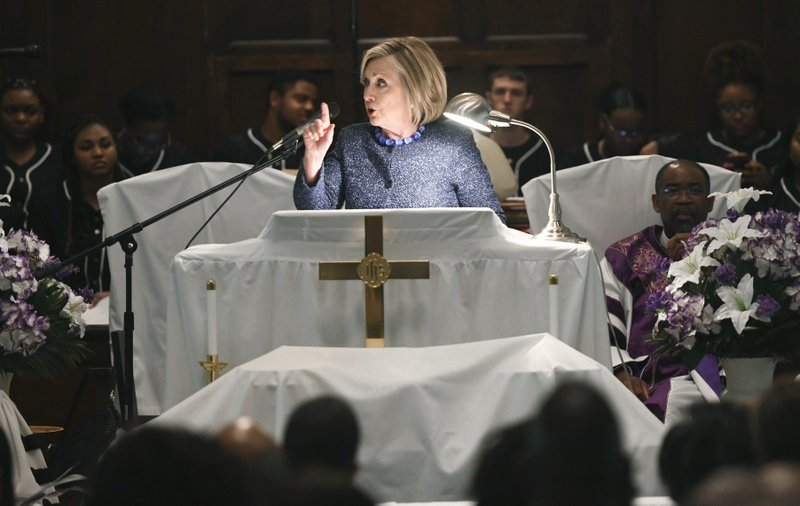 Former Secretary of State Hillary Clinton speaks during a commemorative service marking the anniversary of