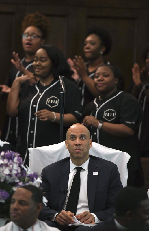 U.S. Sen. Cory Booker, D-N.J., listens to the choir sing before speaking during a commemorative service marking the anniversary of