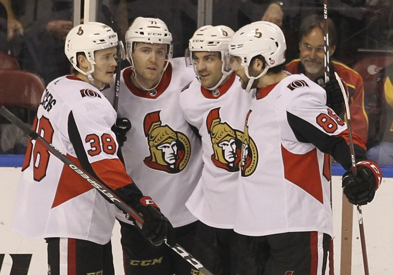 From left to right, Ottawa Senators' Rudolfs Balcers (38) celebrates with teammates Chris Tierney, Dylan DeMelo and Christian Wolanin after scoring a goal against the Florida Panthers during the second period of an NHL hockey game, Sunday, March 3, 2019, in Sunrise, Fla. (AP Photo/Luis M. Alvarez)